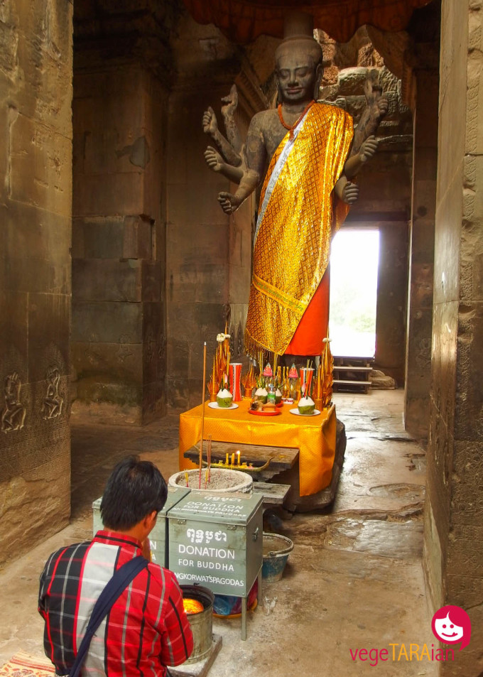 Praying inside Angkor Wat